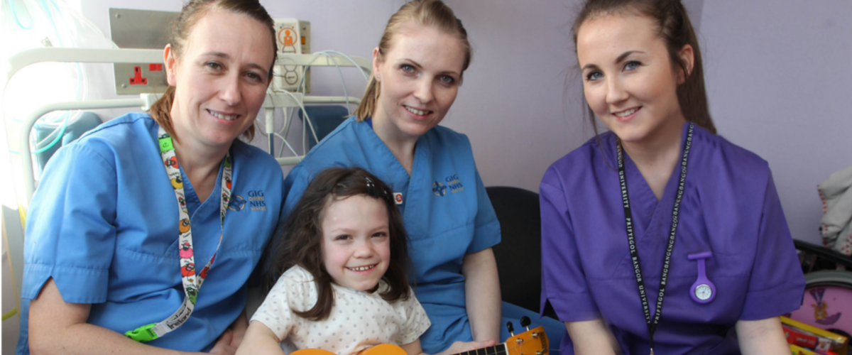 Image of 3 nurses with a little girl